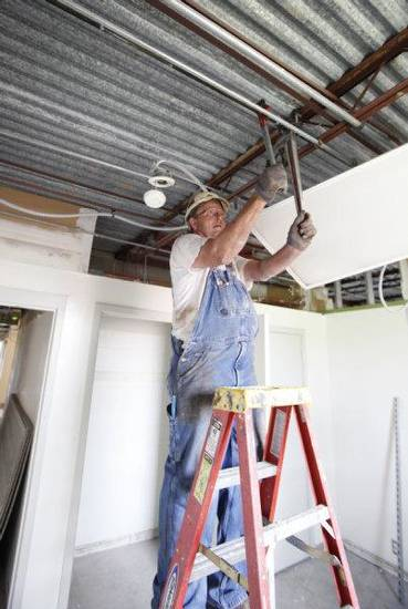 Larry Ferrell installs a fire sprinkler in Oklahoma Christian University's Honors House, which will open this fall to honors students. PHOTO BY STEVE GOOCH, THE OKLAHOMAN <strong>Steve Gooch</strong>