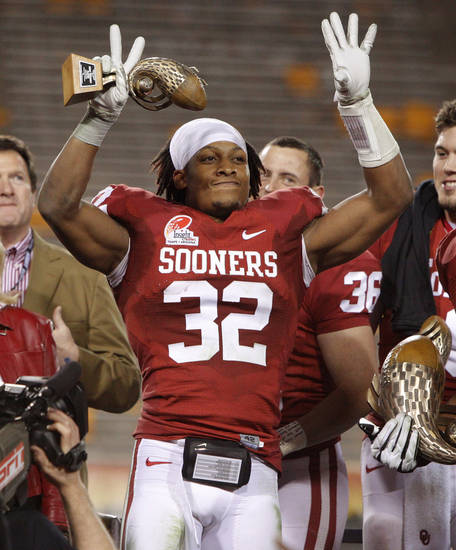 Oklahoma's Jamell Fleming (32) reacts after being named the defensive player of the game following Oklahoma's win in the Insight Bowl college football game between the University of Oklahoma (OU) Sooners and the Iowa Hawkeyes at Sun Devil Stadium in Tempe, Ariz., Friday, Dec. 30, 2011. Photo by Bryan Terry, The Oklahoman