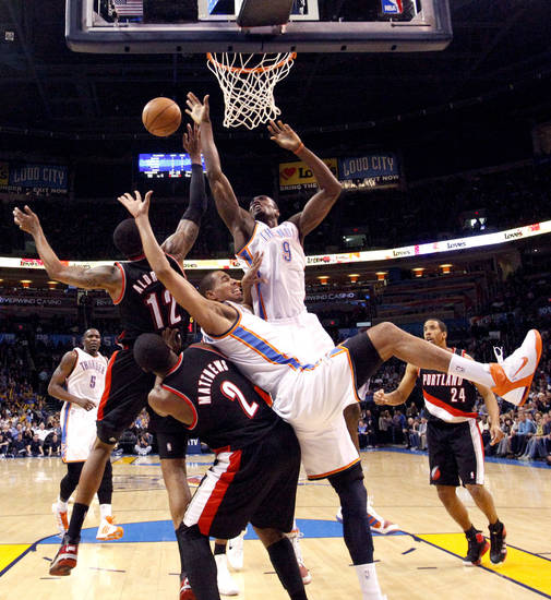 Oklahoma City's Serge Ibaka (9) and  Thabo Sefolosha (2) fights for a rebound with Portland's Wesley Matthews (2) and LaMarcus Aldridge (12) during the NBA game between the Oklahoma City Thunder and the Portland Trailblazers, Sunday, March 27, 2011, at the Oklahoma City Arena. Photo by Sarah Phipps, The Oklahoman