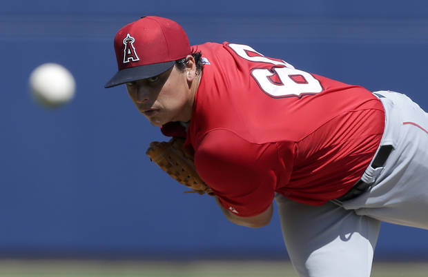 Los Angeles Angels starting pitcher Jason Vargas throws to the Milwaukee Brewers during the firs inning of a spring training baseball game in Phoenix, Ariz. Tuesday, March 19, 2013. (AP Photo/Chris Carlson)
