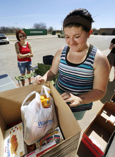 Jordan Eshbaugh, 14, collects snacks and personal care items for a care package.