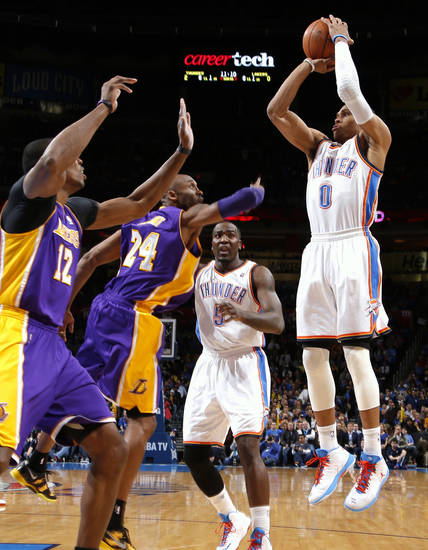 Oklahoma City's Russell Westbrook shiots the ball over Los Angeles' Kobe Bryant and Dwight Howard, at left, during an NBA basketball game between the Oklahoma City Thunder and the Los Angeles Lakers at Chesapeake Energy Arena in Oklahoma City, Tuesday, March 5, 2013. Photo by Bryan Terry, The Oklahoman