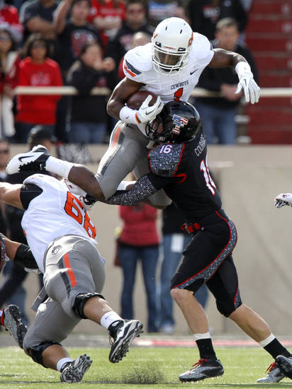 Texas Tech's Cody Davis (16) pushes Oklahoma State's Joseph Randle (1) out of bounds as Lane Taylor (68) blocks during a college football game between Texas Tech University (TTU) and Oklahoma State University (OSU) at Jones AT&T Stadium in Lubbock, Texas, Saturday, Nov. 12, 2011.  Photo by Sarah Phipps, The Oklahoman  ORG XMIT: KOD