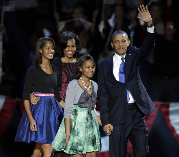 President Barack Obama waves as he walks on stage with first lady Michelle Obama and daughters Malia and Sasha at his election night party Wednesday, Nov. 7, 2012, in Chicago. President Obama defeated Republican challenger former Massachusetts Gov. Mitt Romney.(AP Photo/Chris Carlson)