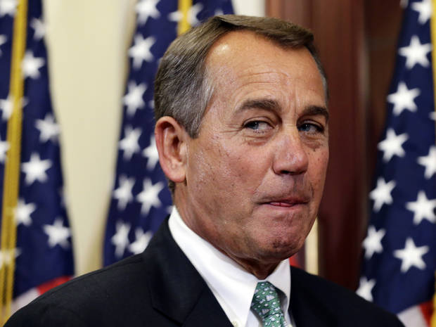   House Speaker John Boehner of Ohio, pauses between ceremonial swearing-ins of new House members, on Capitol Hill Tuesday, Nov. 13, 2012, in Washington. (AP Photo/Alex Brandon)  