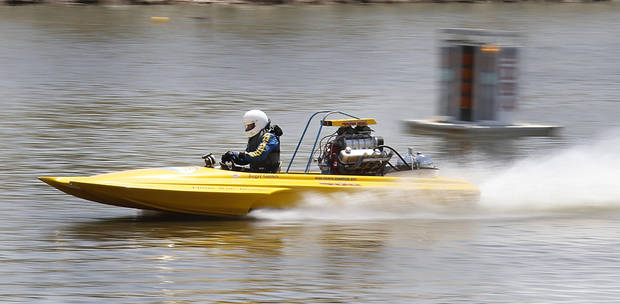 Roger Gaines takes a test run during the Oklahoma City Nationals professional drag boat racing on the Oklahoma River in Oklahoma City, Thursday, June 8, 2012. Photo By Steve Gooch, The Oklahoman