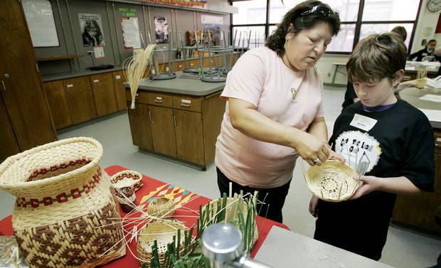 Sue Fish of Norman teaches Native American Basket Weaving to Brad Swain, 9, from Eisenhower Feb. 7, 2009 at the Get the Lead Out conference at Longfellow Middle School. BY JACONNA AGUIRRE, THE OKLAHOMAN