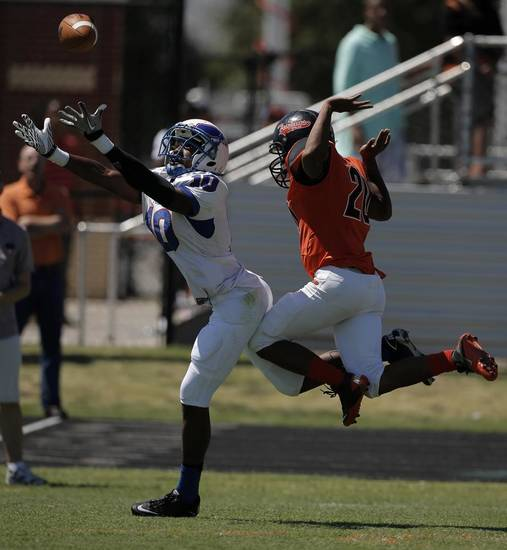 Douglass's Brandon Gaddis (20) tries to block a pass intended for Millwood's Alfonso McMillan (10) during a high school football game between Douglass and Millwood in Oklahoma City, Saturday, Sept. 8, 2012.  Photo by Garett Fisbeck, The Oklahoman