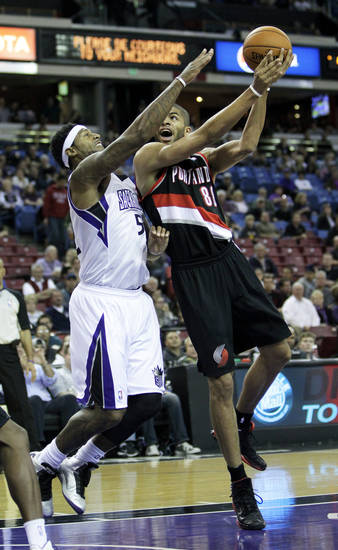 Portland Trail Blazers forward Nicolas Batum, of France, right, shoots over Sacramento Kings forward James Johnson during the first half of an NBA basketball game in Sacramento, Calif., Tuesday, Nov. 13, 2012. (AP Photo/Rich Pedroncelli)