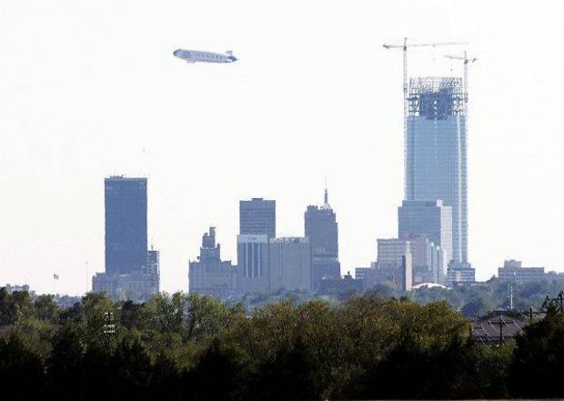 The Farmers Airship, the world's largest airship and one of only two zeppelins in the world passes south of downtown Oklahoma City Monday, September 19, 2011 . Photo by Doug Hoke, The Oklahoman. ORG XMIT: KOD