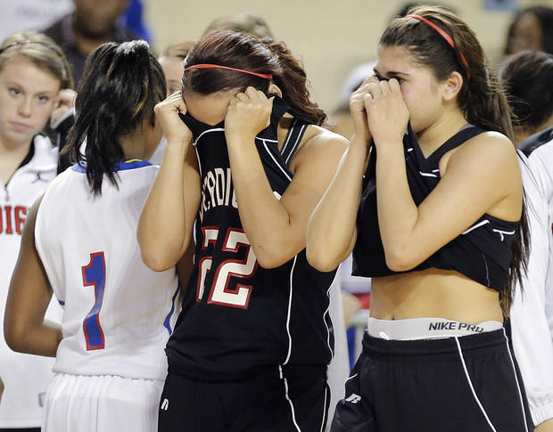 Verdigris' Camry Collins (22) and Caitlyn Hanslovan (1) react after the 54-47 loss during the 3A girls quarterfinals game between Millwood High School and Verdigris High School at the State Fair Arena on Thursday, March 7, 2013, in Oklahoma City, Okla. Photo by Chris Landsberger, The Oklahoman