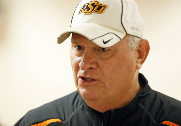 talks to the media after football practice in Stillwater, Okla., Friday, Dec. 14, 2012. Photo by Nate Billings, The Oklahoman