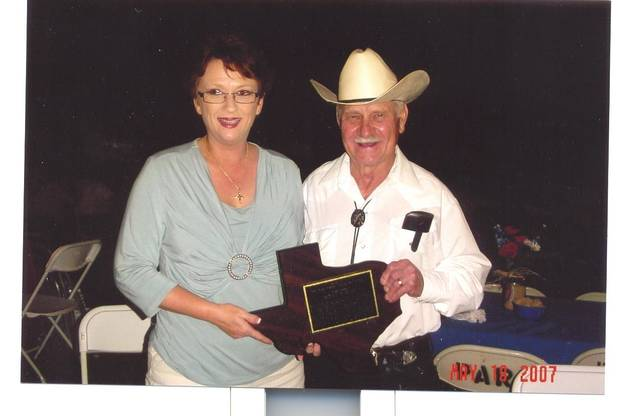 Paula and Benny Kubiak with his Texas-shaped plaque for induction into the Texas Western Swing Hall of Fame<br/><b>Community Photo By:</b> Courtesy of Benny Kubiak<br/><b>Submitted By:</b> Karen, Harrah