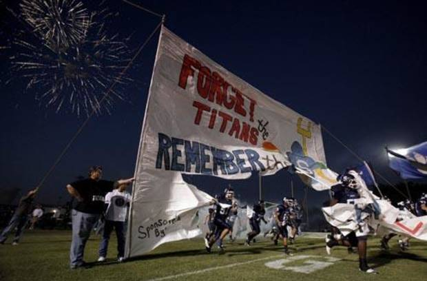 The Shawnee Wolves run onto the field before the high school football game between Shawnee and Carl Albert Friday, 0ct. 2, 2009, at the Jim Thorpe Stadium in Shawnee, Okla.                              </span>                             <!--                              <h4>This post is categorized:</h4>                             <a href=