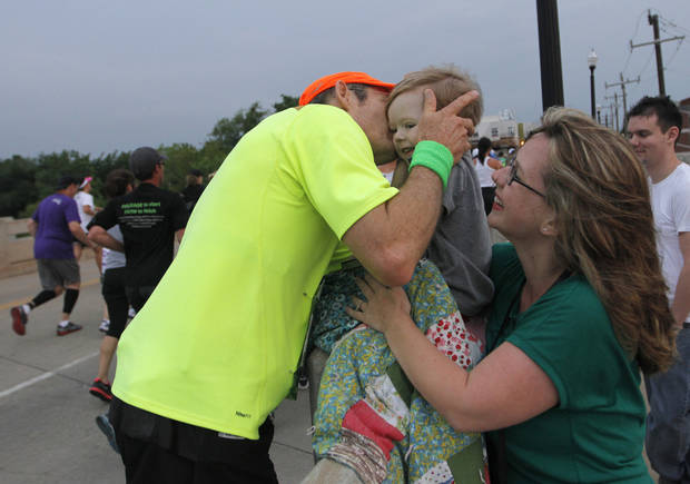 Jimmy Scroggins, of Oklahoma City, greets his grandson Tristan Baisden, 2, and daughter Rebecca Baisden, during the twelfth annual Oklahoma City Memorial Marathon in Oklahoma City, Sunday, April 29, 2012.  Photo by Garett Fisbeck, For The Oklahoman
