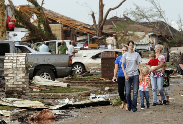 People walk through a neighborhood south of SW 149th between Western and Hudson after a tornado struck south Oklahoma City and Moore, Okla., Monday, May 20, 2013. Photo by Nate Billings, The Oklahoman