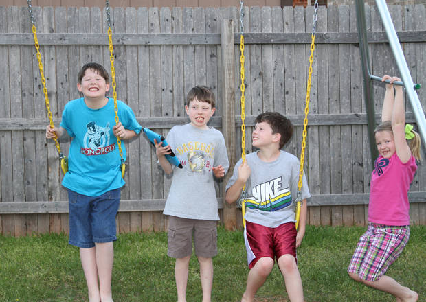 Danielle and Duane Howell�s children � Jacob, Harrison, Keegan and Libby � play in the backyard of their Yukon home. Photos by Clifton Adcock, Oklahoma Watch
