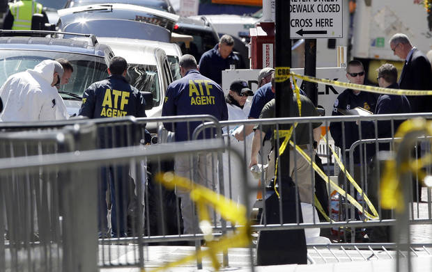 ATF agents and others examine an area of Boylston Street in Boston Thursday, April 18, 2013, as investigation of the Boston Marathon bombings continues. (AP Photo/Elise Amendola)