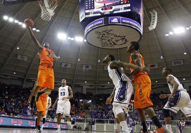Oklahoma State guard Marcus Smart (33) goes up for a basket after getting by TCU 's Devonta Abron (23) in the first half of an NCAA basketball game on Wednesday, Feb. 27, 2013, in Fort Worth, Texas. (AP Photo/Tony Gutierrez) ORG XMIT: TXTG102