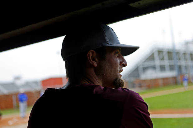 HIGH SCHOOL BASEBALL: Capitol Hill baseball coach Mike Hinckley watches from the dugout during a game in Oklahoma City, Tuesday, April 16, 2013. Photo by Bryan Terry, The Oklahoman