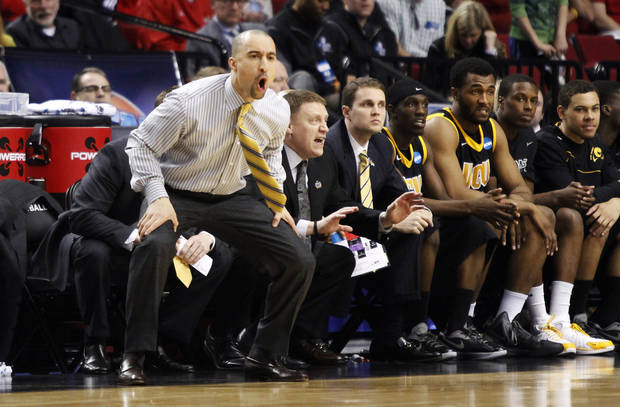 Virginia Commonwealth coach Shaka Smart yells from the bench during the first half of their NCAA tournament third-round college basketball game against Indiana in Portland, Ore., Saturday, March 17, 2012. (AP Photo/Don Ryan)