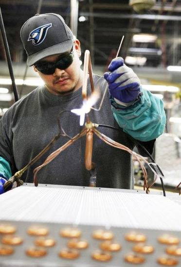 ClimateMaster employee Mike Molina assembles an air coil in Oklahoma City , Monday, November, 2011. Photo by Steve Gooch, The Oklahoman <strong>Steve Gooch</strong>