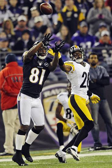 Baltimore Ravens wide receiver Anquan Boldin (81) reaches for a touchdown pass under pressure form Pittsburgh Steelers defensive back Cortez Allen, right, during the first half of an NFL football game in Baltimore, Sunday, Dec. 2, 2012. (AP Photo/Nick Wass)