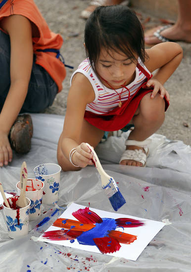 Right: Amanda Southarath, 4, paints a picture during the  Second Friday Circuit of Art event.   PHOTOS BY STEVE SISNEY, THE OKLAHOMAN