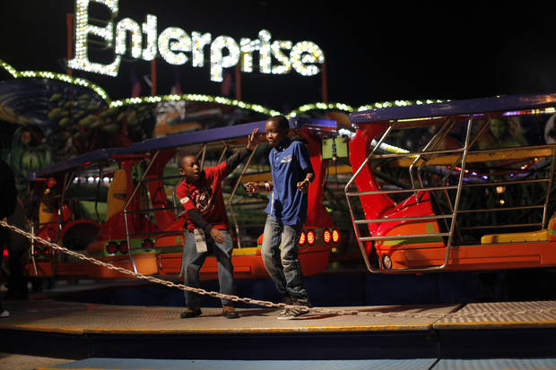 "Children leave the ride ""Enterprise"" during the 2012 Oklahoma State Fair in Oklahoma City, Saturday, Sept. 15, 2012.  Photo by Garett Fisbeck, The Oklahoman"