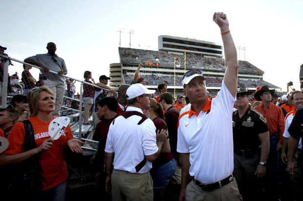 Oklahoma State head coach Mike Gundy celebrates the Cowboys win over Texas A&M in College Station, Texas, on Saturday. Photo by Sarah Phipps, The Oklahoman
