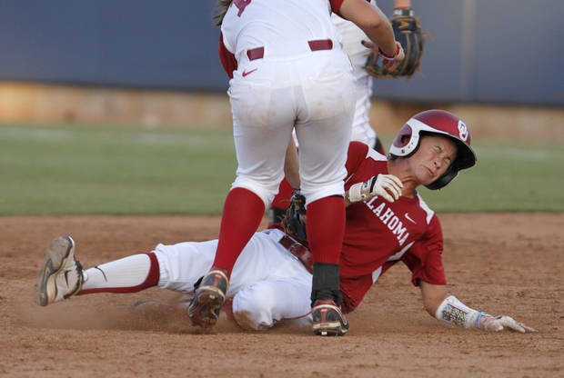 Oklahoma's Brianna Turang (2) is tagged by Alabama's Kaila Hunt (10) during a Women's College World Series game between OU and Alabama at ASA Hall of Fame Stadium in Oklahoma City, Monday, June 4, 2012.  Photo by Garett Fisbeck, The Oklahoman