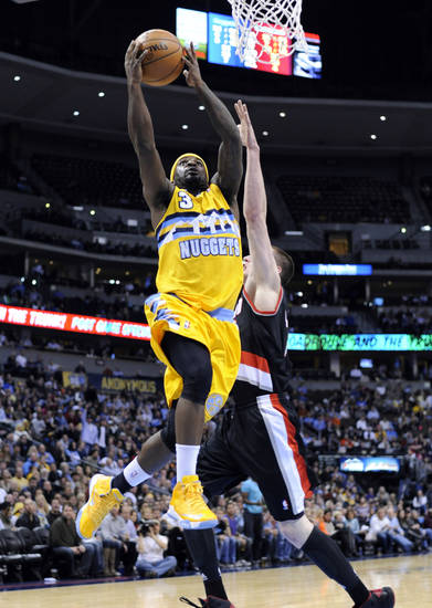Denver Nuggets guard Ty Lawson (3) goes up for a shot against Portland Trail Blazers forward Luke Babbitt (8) during the third quarter of an NBA basketball game, Tuesday, Jan. 15, 2013, in Denver. (AP Photo/Jack Dempsey)