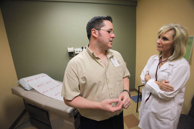 Former patient Shawn Adams visits with Dr. Sherri Tucker at Ministries of Jesus in Edmond. Photo By David McDaniel, The Oklahoman