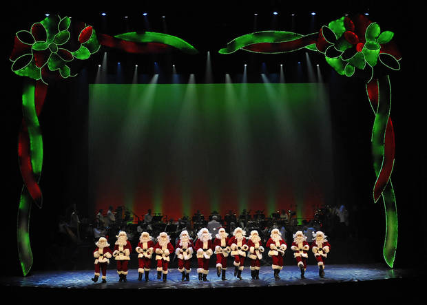 "A line of dancing Santas at the Oklahoma City Philharmonic's ""The Christmas Show.""   Photo by Wendy Mutz <strong>Photo by Wendy Mutz</strong>"