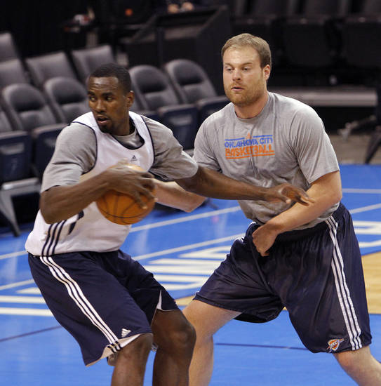 Dave Bliss goes through drills with Oklahoma City's Serge Ibaka during the NBA Finals practice day at the Chesapeake Energy Arena on Monday, June 11, 2012, in Oklahoma City, Okla. Photo by Chris Landsberger, The Oklahoman
