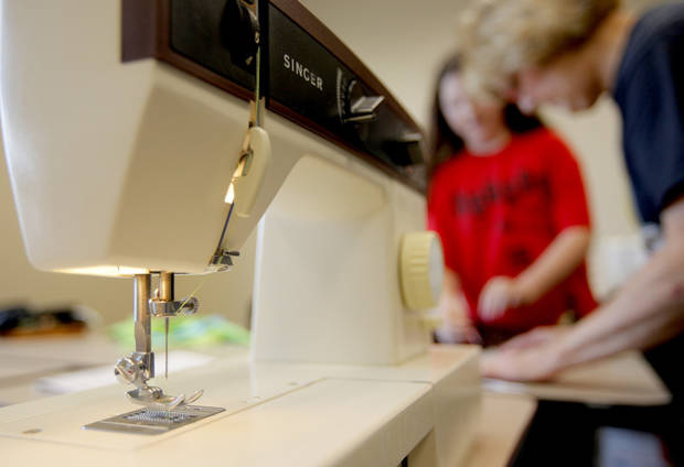 Jeanine Smith helps Macy Huston, 10, during a sewing class for kids at the Multi-Activity Center in Edmond, Okla., Tuesday, May 26, 2009. Photo by Bryan Terry, The Oklahoman