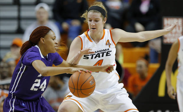 Oklahoma State's Liz Donohoe (4) defends TCU's Natalie Ventress (24) during a women's college basketball game between Oklahoma State University and TCU at Gallagher-Iba Arena in Stillwater, Okla., Tuesday, Feb. 5, 2013. Photo by Bryan Terry, The Oklahoman