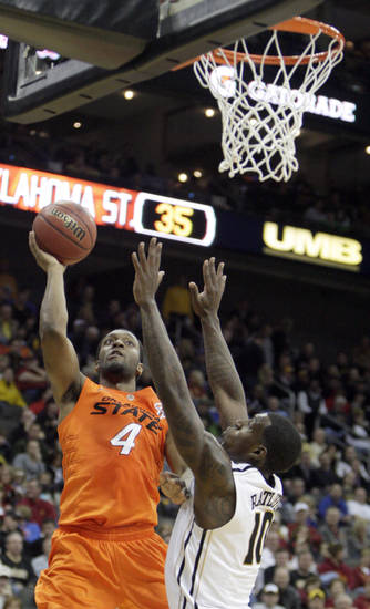Oklahoma's Brian Williams (4) shoots over Missouri's Ricardo Ratliffe (10) during the Big 12 tournament men's basketball game between the Oklahoma State Cowboys and Missouri Tigers the Sprint Center, Thursday, March 8, 2012 Photo by Sarah Phipps, The Oklahoman