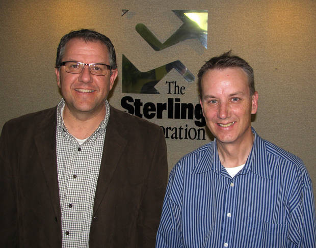   Republican consultants Jeff Timmer and Mark Pischea of The Sterling Corp., pose for a photo Friday, May 4, 2012, in Lansing, Mich. Timmer and Pischea have joined in an unusual partnership with Democratic consultants at Byrum &amp; Fisk Advocacy Communications to promote a November ballot issue that would increase renewable energy requirements. (AP Photo/Kathy Barks Hoffman)  