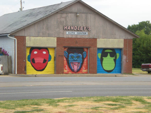 These three monkey or gorilla faces have appeared on Handley's Garage in Midwest City. - PHOTO BY MARY PHILLIPS, THE OKLAHOMAN
