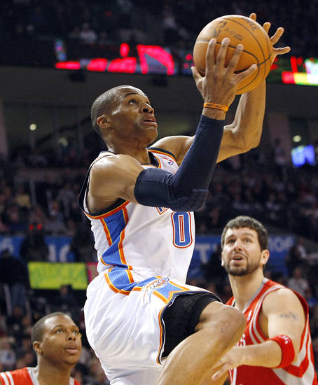 Oklahoma City's Russell Westbrook puts up a shot in front of Houston's defense during their NBA basketball game at the OKC Arena in downtown Oklahoma City on Wednesday, Nov. 17, 2010. Photo by John Clanton, The Oklahoman