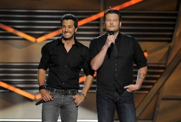 Luke Bryan and Oklahoma native Blake Shelton appear onstage during the 2013 Academy of Country Music Awards in April. (AP file)
