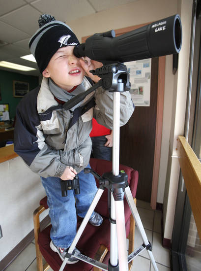 Josiah Jones, 9, searches for eagles during the annual eagle watch at Arcadia Lake.