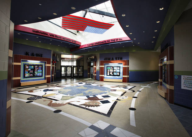 Architectural details and bright colors adorn an open entry space at the new Ronald Reagan Elementary School in Norman. PHOTO BY STEVE SISNEY, THE OKLAHOMAN <strong>STEVE SISNEY</strong>
