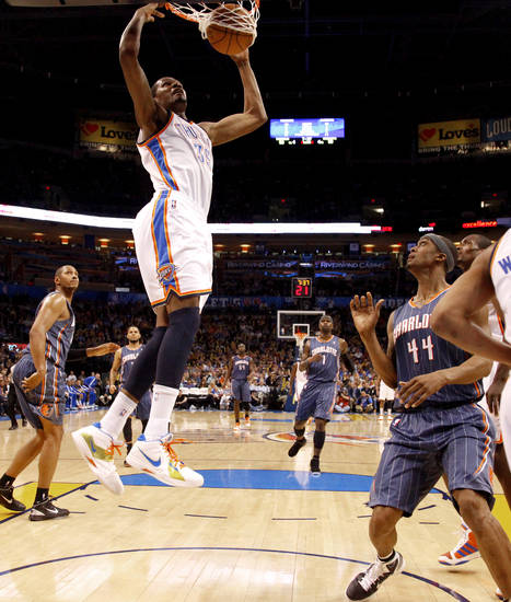 Oklahoma City's Kevin Durant (35) dunks the ball beside Charlotte's Dante Cunningham (44) during an NBA basketball game between the Oklahoma City Thunder and the Charlotte Bobcats at the Oklahoma City Arena, Friday, March 18, 2011. Photo by Bryan Terry, The Oklahoman
