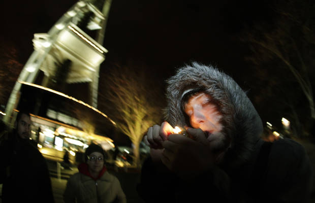 C. Nash smokes marijuana in a glass pipe, Thursday, Dec. 6, 2012, just after midnight at the Space Needle in Seattle. Possession of marijuana became legal in Washington state at midnight, and several hundred people gathered at the Space Needle to smoke and celebrate the occasion, even though the new law does prohibit public use of marijuana. (AP Photo/Ted S. Warren)