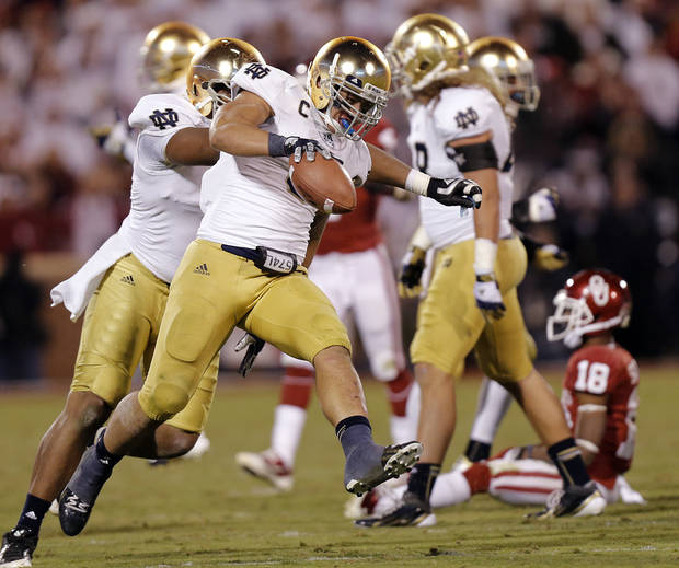 Notre Dame 's Manti Te'o (5) reacts after making an interception on a pass for OU's Jalen Saunders (18) during the college football game between the University of Oklahoma Sooners (OU) and the Notre Dame Fighting Irish at the Gaylord Family-Oklahoma Memorial Stadium on Saturday, Oct. 27, 2012, in Norman, Okla. Photo by Chris Landsberger, The Oklahoman