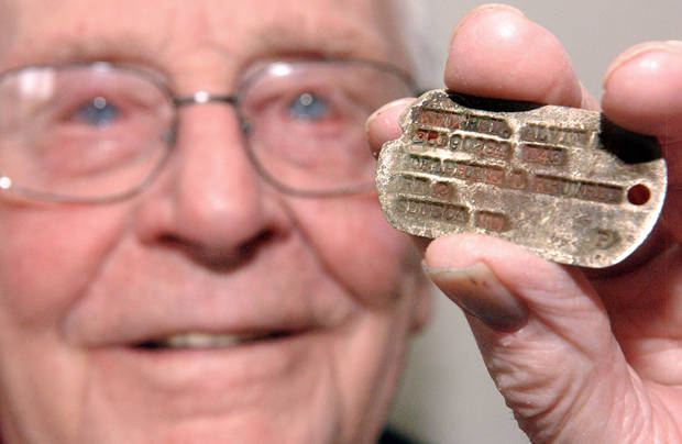 Alvin Krumley, of Commerce, OK, holds the dog tag that was returned to him after 70 years. PHOTO BY GARY CROW, FOR THE OKLAHOMAN <strong>GARY CROW</strong>