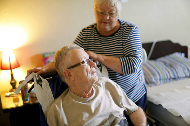 B.J. Matthews talks with her husband, Bob, at an Oklahoma City rehabilitation center Tuesday. Photo by Sarah Phipps, The Oklahoman