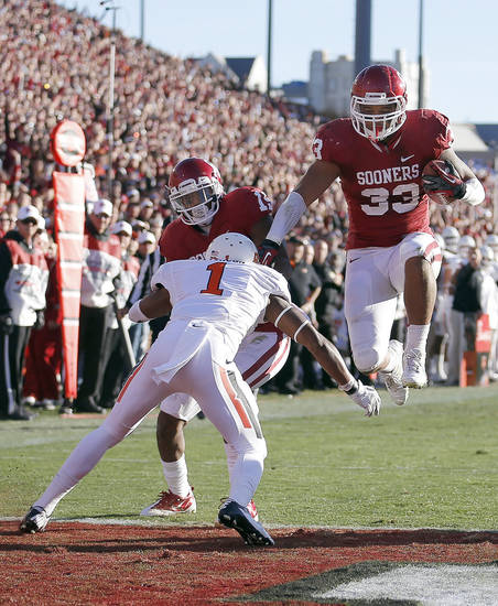 Oklahoma's Trey Millard (33) leaps into the endzone for a touchdown during the Bedlam college football game between the University of Oklahoma Sooners (OU) and the Oklahoma State University Cowboys (OSU) at Gaylord Family-Oklahoma Memorial Stadium in Norman, Okla., Saturday, Nov. 24, 2012. Photo by, Sarah Phipps The Oklahoman